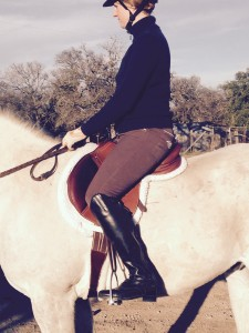Definitely too small, but leg position is improved. Trainer says shorten the stirrups and send more pics.