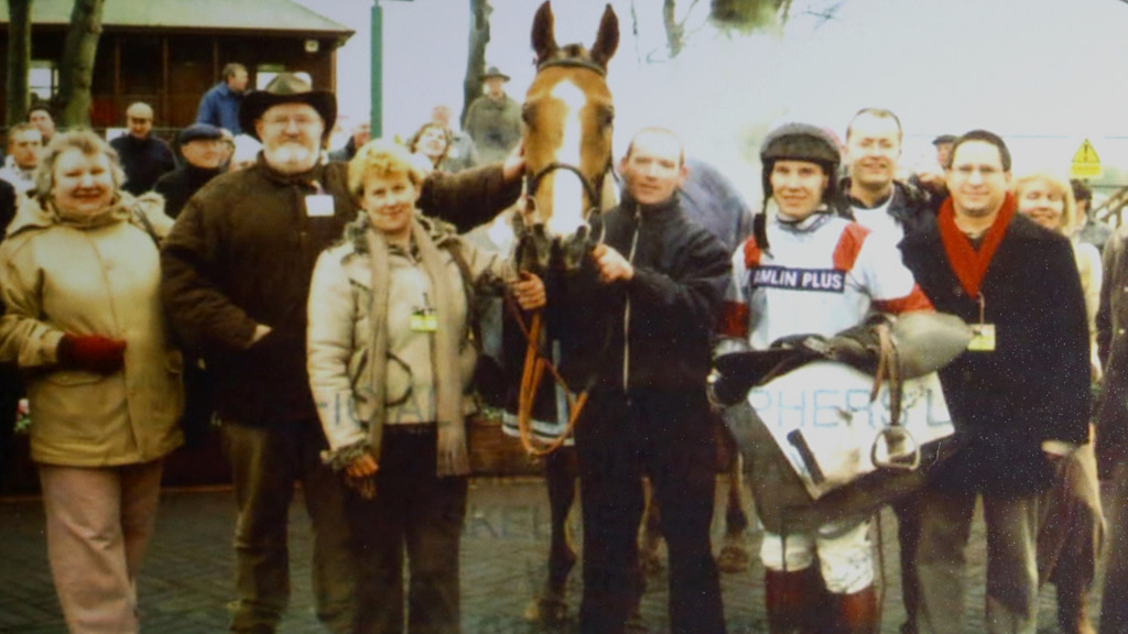 Dream Alliance in a win picture with a few of his syndicate owners, jockey, and trainers