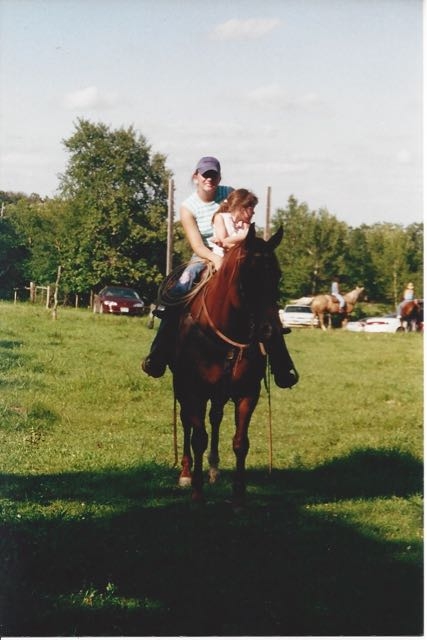 Riding at a family reunion with my youngest cousin (who is in college now, this photo makes me feel really old).